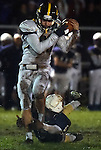 (Lexington MA 10/28/16) Andover 88, Cedric Gillette, with an over the shoulder catch,Lexington 5, Timothy Fleming, grabs him by his ankle, during the first half, Friday, Oct 28, 2016, at Lexington High School. (Jim Michaud / Journal Inquirer)