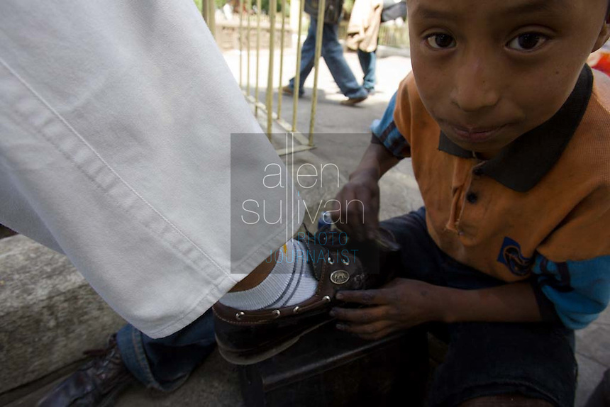 Elias , 9, shines shoes at the central park in Chimaltenango, Guatemala on Thursday, March 8, 2007. The boy said he works here every day and has never been to school.