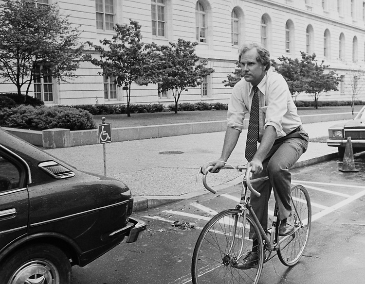 Rep. Andrew Maguire, D-N.J., riding bicycle. (Photo by Keith Jewell/CQ Roll Call)