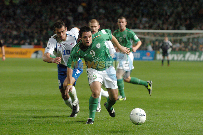 Dublin Ireland, Irelands No 9 Andy Reid  holds off Faroe Islands No 10 John Petersen in the Ireland V Faroe Islands 2006 FIFA World Cup Group 6 Qualifier. 13-10-04 in Lansdowne Road, Dublin Ireland..Photo AFP/NEWSFILE/FRAN CAFFREY..(Photo credit should read FRAN CAFFREY/NEWSFILE/AFP)...This Picture has been sent you under the condtions enclosed by:.Newsfile Ltd..the Studio,.Millmount Abbey,.Drogheda,.Co Meath..Ireland..Tel: +353(0)41-9871240.Fax: +353(0)41-9871260.GSM: +353(0)86-2500958.email: pictures@newsfile.ie.www.newsfile.ie.FTP: 193.120.102.198..This picture is from Fran Caffrey@newsfile.ie