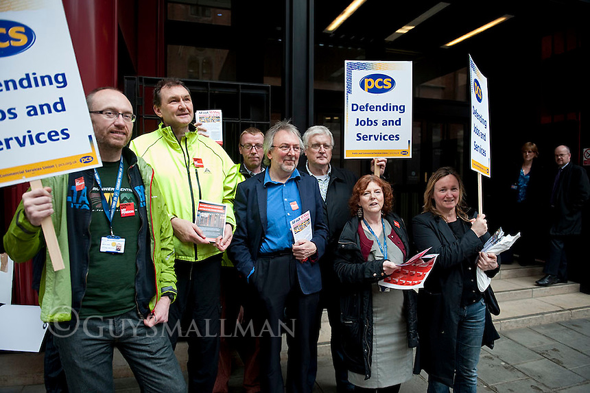 Public sector strikes over pension cuts. 10-5-12 Members of the PCS, UNITE, NUT and RMT Trade Unions strike over cuts to their pensions. The PCS picket line at the British Library is joined by NUT deputy General Secretary Kevin Courtney.