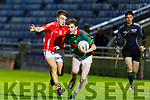 Darragh O'Dowd of  Mid Kerry tries to shake of the challenge of East Kerry's Tomas Clifford in the U16 District Championship Cup Final.