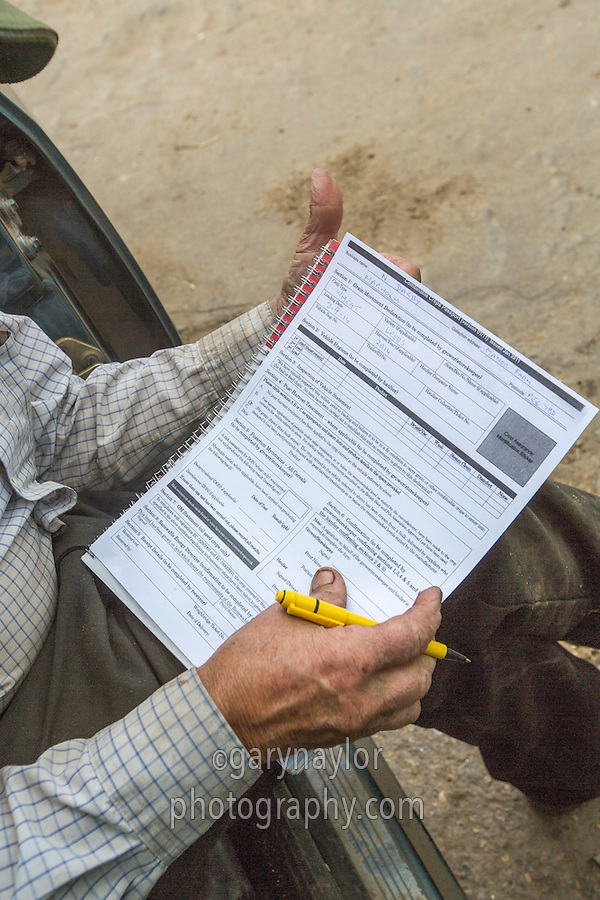 Completing a combinable crops passport for a load of wheat leaving a farm store