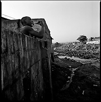 Luanda, Angola, May, 20, 2006.Porto do Pesqueiros, living next to an open air sewer; cholera infected waters. Between February and June 2006, more than 30000 people were infected with cholera in Angola's worse outbreak ever; more than 1300 died.