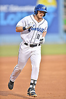 Asheville Tourists left fielder Casey Golden (11) rounds the bases after hitting a home run during a game against the Lexington Legends at McCormick Field on May 25, 2018 in Asheville, North Carolina. The Tourists defeated the Legends 6-4. (Tony Farlow/Four Seam Images)