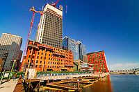 Cranes working on a new building in Boston near the river