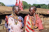 Lolgorian, Kenya. Siria Maasai Manyatta; two smiling woman, traditional beadwork earrings, decorations, extended ear piercing.
