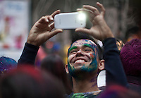 A man Takes a picture with a smart phone as he takes part during Holi Hai Celebration in New York , March 31, 2013. The festival has many purposes. First and foremost, it celebrates the beginning of the new season, spring.VIEWpress /Kena Betancur