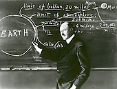 """Doctor Robert H. Goddard at a blackboard at Clark University in Worcester, Massachusetts, in 1924. Goddard began teaching physics in 1914 at Clark and in 1923 was named the Director of the Physical Laboratory. In 1920 the Smithsonian Institution published his seminal paper A Method for Reaching Extreme Altitudes where he asserted that rockets could be used to send payloads to the Moon. Declaring the absurdity of rockets ever reaching the Moon, the press mocked Goddard and his paper, calling him """"Moon Man."""" To avoid further scrutiny Goddard eventually moved to New Mexico where he could conduct his research in private. Doctor Goddard, died in 1945, but was probably as responsible for the dawning of the Space Age as the Wrights were for the beginning of the Air Age. Yet his work attracted little serious attention during his lifetime. However, when the United States began to prepare for the conquest of space in the 1950's, American rocket scientists began to recognize the debt owed to the New England professor. They discovered that it was virtually impossible to construct a rocket or launch a satellite without acknowledging the work of Doctor Goddard. .Credit: NASA via CNP"""