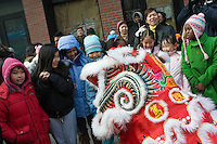 New York, NY - 26 January 2009 - CHildren are g reeted by a Lion Dancer as the Chinatown community marks the Year of the Ox.