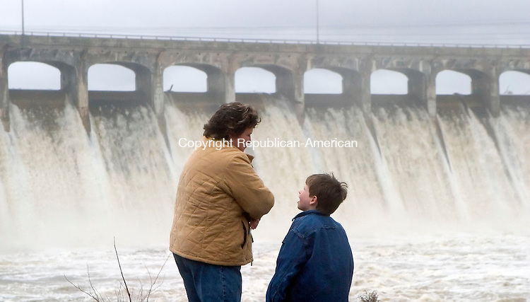 OXFORD, CT- 16 APRIL 07- 041607JT06- <br /> Sandy Zuvanich, of Sandy Hook, answers a question from her son Philip, 8, as they watch water pour from Lake Zoar over the Stevenson Dam in Monroe, across the river from Oxford, on Monday.<br /> Josalee Thrift Republican-American