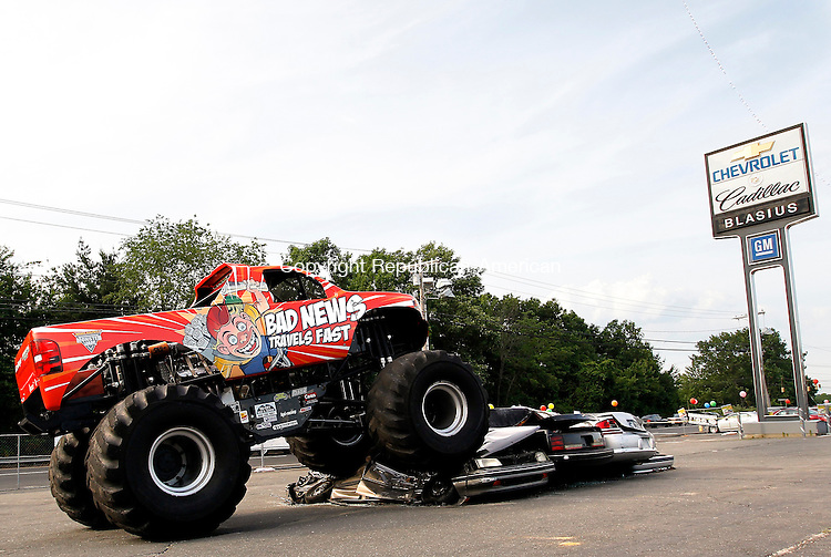 "Waterbury, CT-04, June 2010-060410CM09 ""Bad News Travels Fast"", a monster truck out of Bronson, FL will be featured at Loehmann Blasius Chevrolet on Scott Rd in Waterbury this weekend.  The monster truck will be crushing cars, and availabe for photo oppertunities. Families and kids of all ages are welcome to attend the event, free of charge.  There will be a free raffle Saturday and Sunday.  The winners will have the opportunity to buy used cars for $88 dollars (plus tax and fees).  Car crushing will run Saturday at 11am, 3pm and 6pm and Sunday, at Noon and 3pm. --Christopher Massa Republican-American"