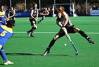 NZ's Simon Childs dodges a pass from Muhammad Amin Rahim during the international hockey match between the New Zealand Black Sticks and Malaysia at Fitzherbert Park, Palmerston North, New Zealand on Sunday, 9 August 2009. Photo: Dave Lintott / lintottphoto.co.nz