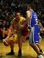 Troy McLean tries to block Ray Cameron during game two of the NBL Final basketball match between the Wellington Saints and Waikato Pistons at TSB Bank Arena, Wellington, New Zealand on Friday 20 June 2008. Photo: Dave Lintott / lintottphoto.co.nz