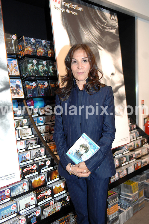 **ALL ROUND PICTURES FROM SOLARPIX.COM**                                             **WORLDWIDE SYNDICATION RIGHTS**                                                                                  Caption:  Olivia Harrison  meeting fans and signing copies of the new DVD, BluRay, Deluxe Edition and Book of the Martin Scorsese documentary 'George Harrison Living In The Material World' at HMV record shop in  Liverpool  Uk                                                                           This pic: Olivia Harrison                                                                                             JOB REF: 14265       SGD       DATE:  01.12.2011                                                          **MUST CREDIT SOLARPIX.COM OR DOUBLE FEE WILL BE CHARGED**                                                                      **MUST AGREE FEE BEFORE ONLINE USAGE**                               **CALL US ON: +34 952 811 768 or LOW RATE FROM UK 0844 617 7637**