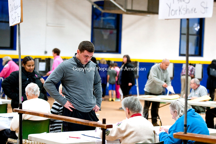 TORRINGTON,  CT-110816JS12- Thomas Somers of Torrington, checks in before casting his votes on Tuesday at the Torrington Armory. during election day Tuesday at the Torrington Armory. <br /> Jim Shannon Republican American