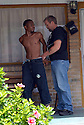 Bounty hunter Matthew Dennis takes a criminal into custody in New Orleans, June 25, 2007...(AP Photo/Cheryl Gerber).