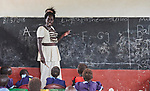 A teacher in class in a primary school in Bunj, South Sudan, sponsored by Jesuit Relief Service. The community is host to more than 130,000 refugees from the Blue Nile region of Sudan, and JRS provides educational and psycho-social services to both refugees and the host community.