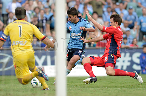 16.02.2013 Sydney, Australia. Sydney midfielder Terry Antonis  under pressure from Adelaide defender Nigel Boogaard during the Hyundai A League game between Sydney FC and Adelaide United from the Allianz Stadium.