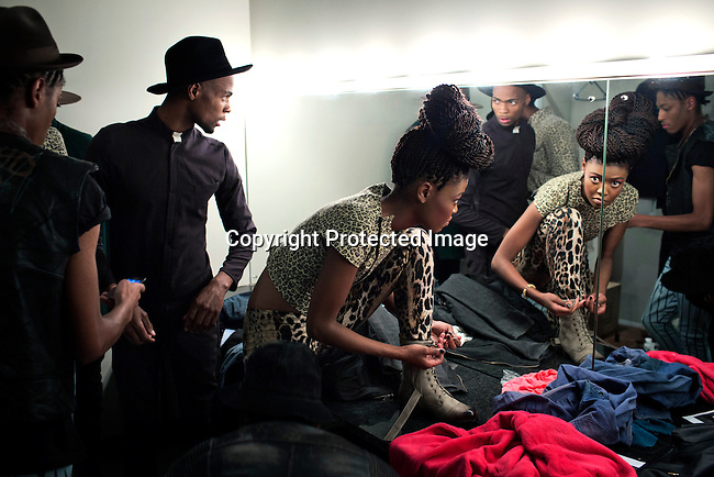 SOWETO, SOUTH AFRICA MAY 29: Models for the designer Avenue Floyd dress backstage before a fashion show at Soweto Fashion Week on May 29, 2014 at the Soweto Theatre in the Jabulani section of Soweto, South Africa. Local emerging designers showed their collections during the three-day event held at the theatre. Founded in 2012, Soweto fashion week gives a platform to local designers, models and artists. (Photo by: Per-Anders Pettersson)