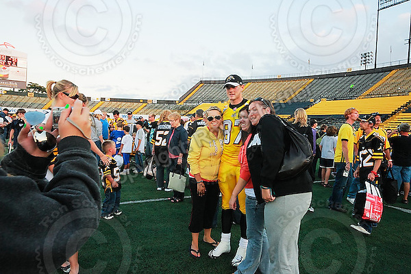 Sep 6, 2008; Hamilton, ON, CAN; Hamilton Tiger-Cats wide receiver Chris Bauman (87) with supporters during a post game autograph session. CFL football - BC Lions defeated the Hamilton Tiger-Cats 35-12 at Ivor Wynne Stadium. Mandatory Credit: Ron Scheffler-www.ronscheffler.com. Copyright (c) Ron Scheffler