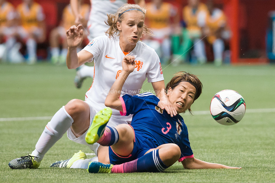 June 23, 2015: Vivianne MIEDEMA of Netherlands and Azusa IWASHIMIZU of Japan fight for the ball during a round of 16 match between Japan and Netherlands at the FIFA Women's World Cup Canada 2015 at BC Place Stadium on 23 June 2015 in Vancouver, Canada. Japan won 2-1. Sydney Low/AsteriskImages.com