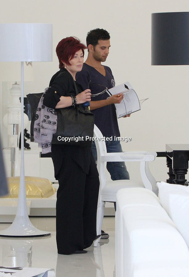 Septemeber 1st 2010 Exclusive ..Sharon Osbourne wearing a purple scarf with skulls on it to match her black purse with skulls. Sharon was shopping for lamps & furniture at a store called Modani in Hollywood. Sharon was wearing black pants & jacket with red hair. ..AbilityFilms@yahoo.com.805-427-3519.www.AbilityFilms.com.