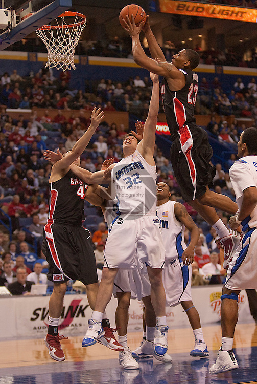 March 5,  2010           Bradley guard Chris Roberts (23) leaps over Creighton forward Casey Harriman (32) and other Bradley teammates in the second half.    Creighton University played Bradley Univesity in Game 4 of the Missouri Valley Conference Tournament at the Scottrade Center in downtown St. Louis, MIssouri on Friday March 5, 2010.  Bradley won, 81-62, and advances.