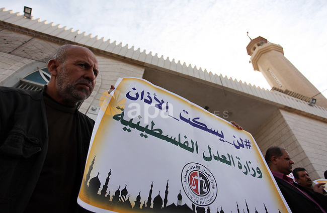 Palestinians hold banners during a protest against a controversial Israeli bill to limit the volume of calls to prayer at mosques in the occupied Jerusalem, in Gaza city on November 23, 2016. Israeli Prime Minister Benjamin Netanyahu said he backed a bill limiting the volume of calls to prayer from mosques, a proposal government watchdogs have called a threat to religious freedom. Photo by Ashraf Amra