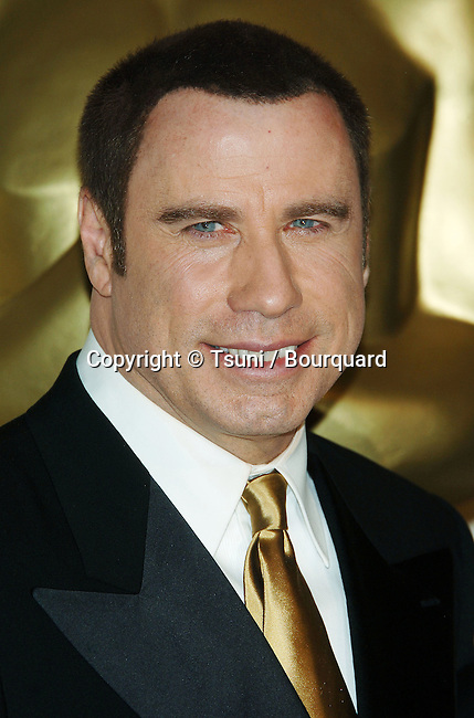 John Travolta backstage at the 78th Academy of Motion Pictures (Oscars)  at the Kodak Theatre in Los Angeles. March 5, 2006