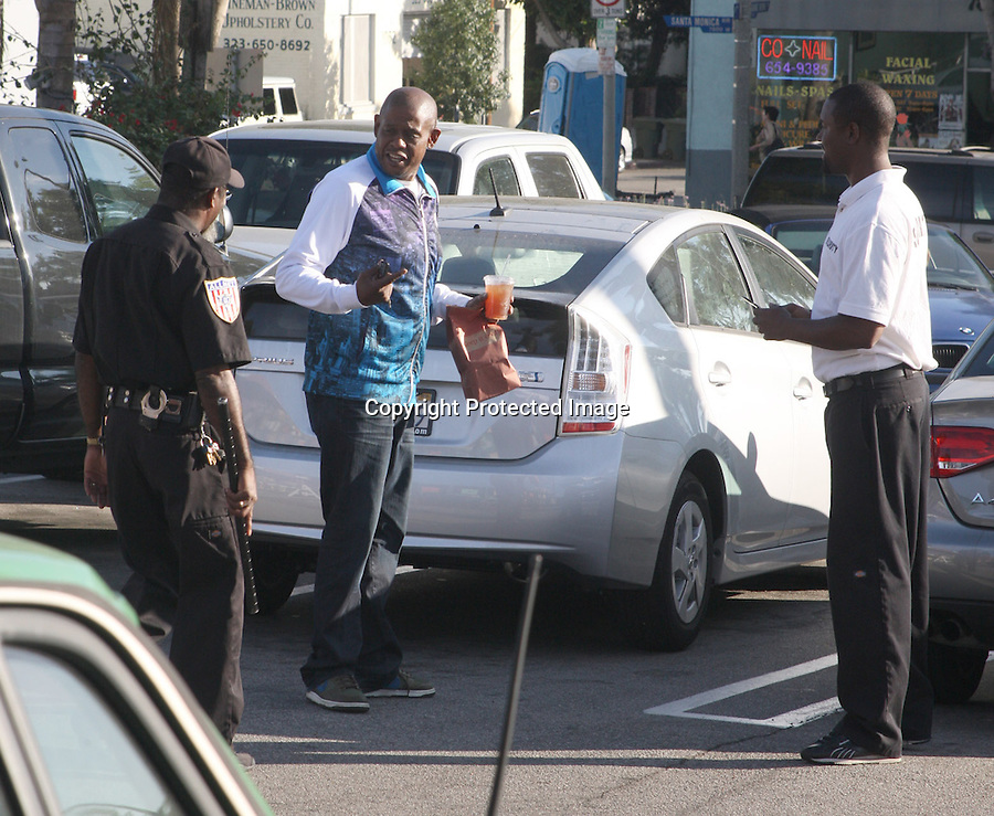 ".Exclusive   11-3-09  ..Mr. Whitaker went inside Whole Foods & bought himself a nice cold ice tea & muffin from ""Keep it Cool"" Los Angeles california ..Forrest Whitaker had parked his car illegally so security was waiting by his Prius so they could scold him & make him move his car.  But once they realized it was Oscar Winner Forest Whitaker they ended up taking pictures with him instead. Then they offered to watch his car for him so he wouldn't get a  parking ticket if he wanted to continue shopping. ....AbilityFilms@yahoo.com.805-427-3519.www.AbilityFilms.com.."