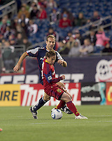 Real Salt Lake midfielder Ned Grabavoy (20) attempts to control the ball as New England Revolution forward Ilija Stolica (9) defends. In a Major League Soccer (MLS) match, Real Salt Lake defeated the New England Revolution, 2-0, at Gillette Stadium on April 9, 2011.