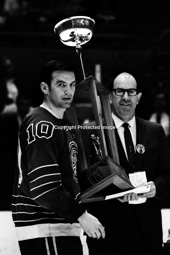 California Golden Seals Ted Hampson getting trophy from Oakland Tribune Sports Editor George Ross.<br />(1969 before game against the L.A.Kings in Oakland)<br />(photo/Ron Riesterer)