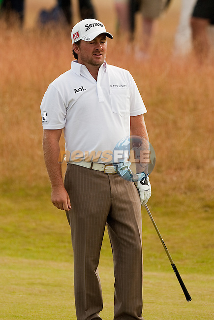 Graeme McDowell cannot believe where his second shot into the 18th green ended up  during the second round  of the Barclays Scottish Open, played over the links at Castle Stuart, Inverness, Scotland from 7th to 10th July 2011:  Picture Stuart Adams /www.golffile.ie 8th July 2011