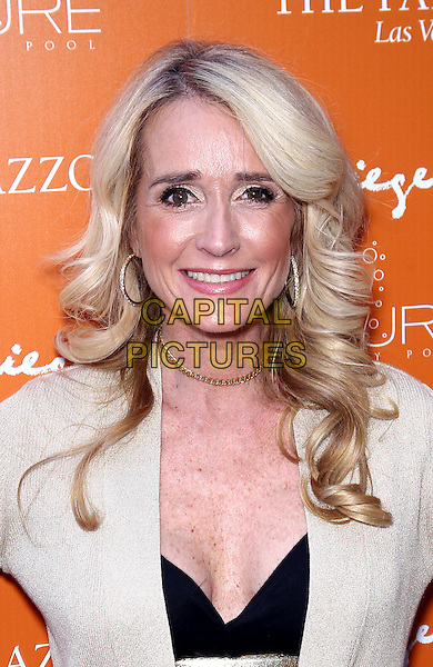 KIM RICHARDS .Beverly Hills Housewives Kim and Kyle Richards host season premiere of Azure Luxury Pool at The Palazzo Resort Hotel and Casino, Las Vegas, Nevada, USA, 10th April 2011..portrait headshot black white cream smiling hoop earrings  gold chain necklace .CAP/ADM/MJT.© MJT/AdMedia/Capital Pictures.