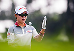 Hyo-Joo Kim of Korea throws her ball during the Hyundai China Ladies Open 2014 on December 10 2014 at Mission Hills Shenzhen, in Shenzhen, China. Photo by Xaume Olleros / Power Sport Images