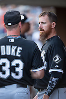 Adam LaRoche (25) of the Chicago White Sox chats with relief pitcher Zach Duke (33) during the game against the Charlotte Knights at BB&T Ballpark on April 3, 2015 in Charlotte, North Carolina.  The Knights defeated the White Sox 10-2.  (Brian Westerholt/Four Seam Images)