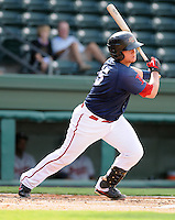 Catcher Christian Vazquez (15) of the Greenville Drive hits in the first game of a doubleheader against the Rome Braves on August 15, 2011, at Fluor Field at the West End in Greenville, South Carolina. (Tom Priddy/Four Seam Images)