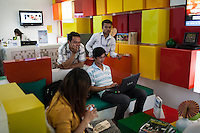 August 07, 2012 - Phnom Penh, Cambodia. People sit in the offices of Digi an internet provider in Phnom Penh. © Nicolas Axelrod / Ruom