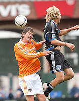 San Francisco, California - Saturday March 17, 2012: Bobby Boswell and Steven Lenhart fights for the ball during the MLS match at AT&T Park. Houston Dynamo defeated San Jose Earthquakes  1-0