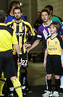 Perth captain Jacob Burns (right) greets Andrew Durante in the players tunnel before kickoff during the A-League football match between Wellington Phoenix and Perth Glory at Westpac Stadium, Wellington, New Zealand on Sunday, 16 August 2009. Photo: Dave Lintott / lintottphoto.co.nz