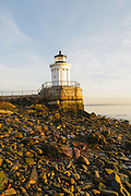 """Portland Breakwater Light in Portland, Maine USA during the spring months. The Portland Breakwater Light is also called the """"Bug Light"""" and it is located at the entrance to Portland Harbor. It was designed after a Greek monument."""