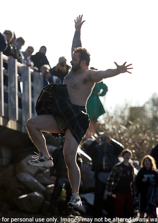 Hank Nelson wears a kilt while participating in the 27th annual Polar Bear jump into the Burley Lagoon in Olalla, Washington on January 1, 2011. Over 300 hardy participants  braved the chilly lagoon waters to join in on the annual New Year's Day Tradition.  ©2011. Jim Bryant. All Rights Reserved.