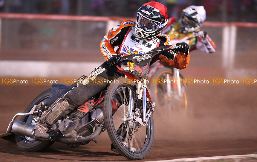 Heat 11: Tai Woffinden (red) and Rory Schlein (white) - Team Great Britain vs Australia Test Match Speedway at the Arena Essex Raceway, Purfleet - 03/06/11 - MANDATORY CREDIT: Rob Newell/TGSPHOTO - Self billing applies where appropriate - 0845 094 6026 - contact@tgsphoto.co.uk - NO UNPAID USE.