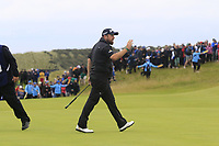 Shane Lowry (IRL) sinks his putt on the 16th green during Sunday's Final Round of the 148th Open Championship, Royal Portrush Golf Club, Portrush, County Antrim, Northern Ireland. 21/07/2019.<br /> Picture Eoin Clarke / Golffile.ie<br /> <br /> All photo usage must carry mandatory copyright credit (© Golffile | Eoin Clarke)