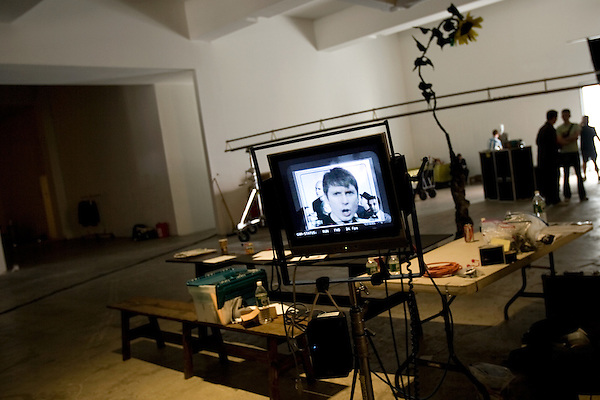 "July 29, 2005. New York , NY.. Lead singer Alex Kapranos is shown on a video monitor..Behind the scenes with Franz Ferdinand during the  filming of the music video "" Do You Want To"" in  Manhattan."