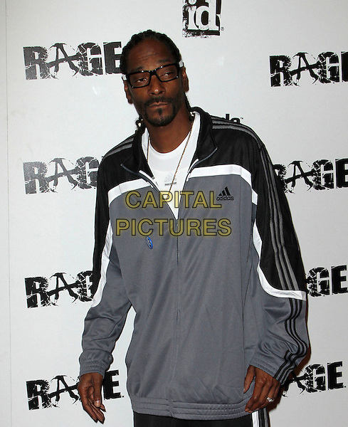 "Snoop Dogg (Cordozar Calvin Broadus).""Rage"" Video Game Launch Party held in Chinatown's Historical Central Plaza, Los Angeles, California,.30th September 2011..half length tracksuit white grey gray blue adidas glasses beard facial hair .CAP/ADM/KB.©Kevan Brooks/AdMedia/Capital Pictures."