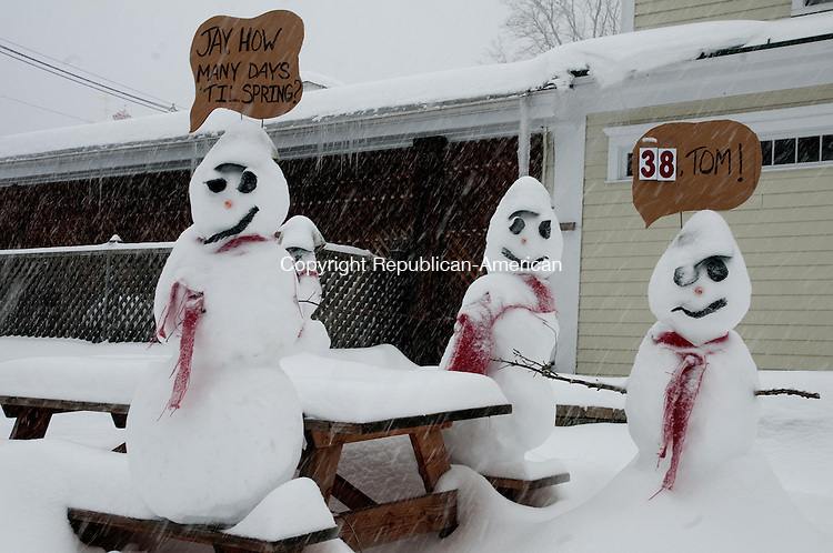 Three snowmen count down to spring outside Washington Supply Co. in Washington Depot Thursday morning. Alec Johnson/ Republican-American