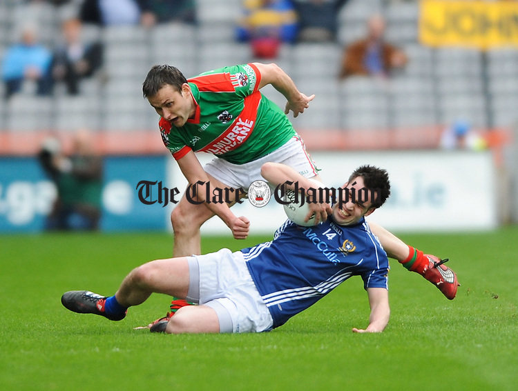 Peter O Dwyer of Kilmurry Ibrickane in action against Kevin Niblock of St Galls of Antrim during the AIB All-Ireland Club senior football final at Croke Park. Photograph by John Kelly.