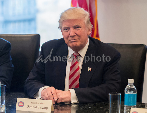 United States President-elect Donald Trump is seen at a meeting of technology leaders in the Trump Organization conference room at Trump Tower in New York, NY, USA on December 14, 2016. Photo Credit: Albin Lohr-Jones/CNP/AdMedia